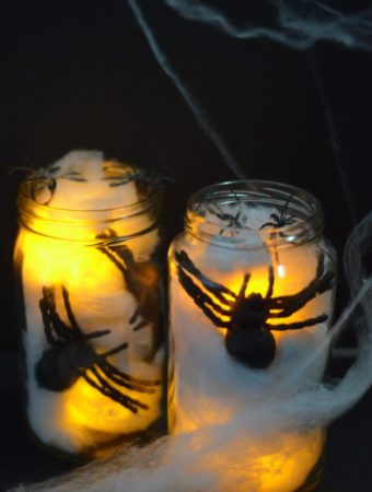 Creepy Crawler Spider Jars by Mooshu Jenne - Spider web, fake spiders, and battery operated tea light candles.