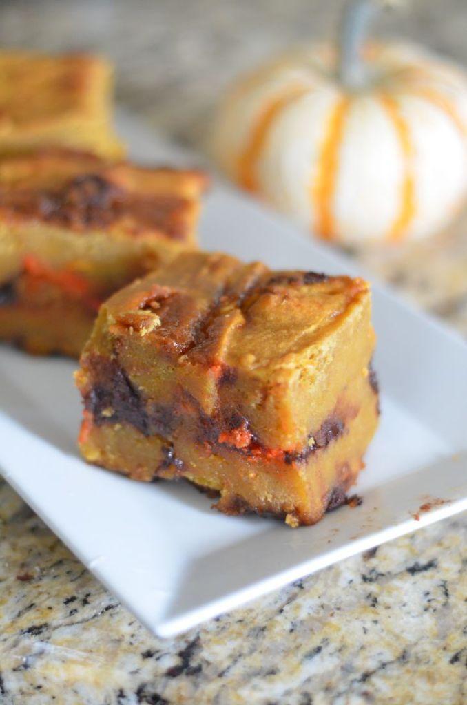 Gooey Pumpkin Blondies by Mooshu Jenne Made with Halloween chocolate chips, fresh pumpkin, and pumpkin spiced marshmallows.