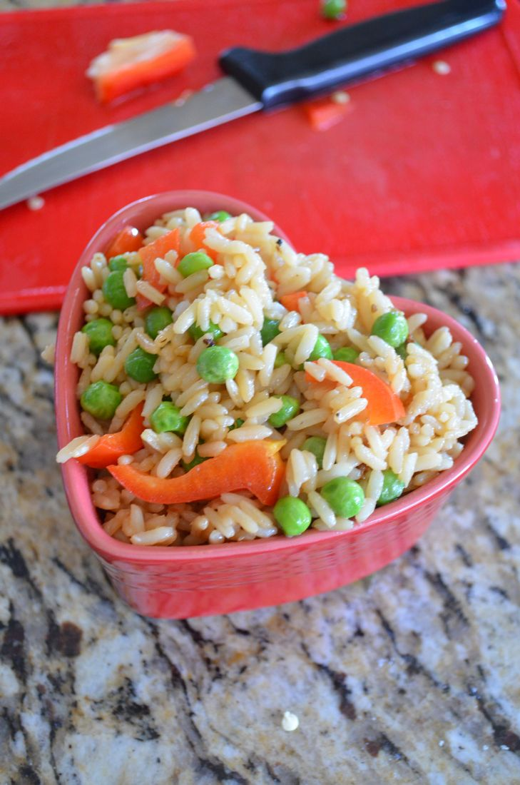 Red Pepper Fried Rice by Mooshu Jenne - Steamed white rice tossed with peas and red peppers for a tasty fried rice.