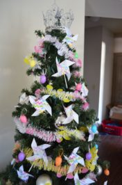 Easter Tree by Mooshu Jenne Decorated with easter eggs, pinwheels, and silver ornament balls.