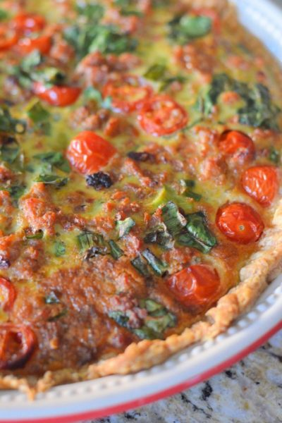 Italian Sausage Tart with spinach, spring onions, tomatoes, egg, and sausage.