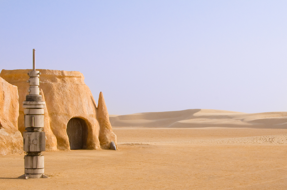 Abandoned sets for the shooting of the movie Star Wars in the Sahara desert on a background of sand dunes.