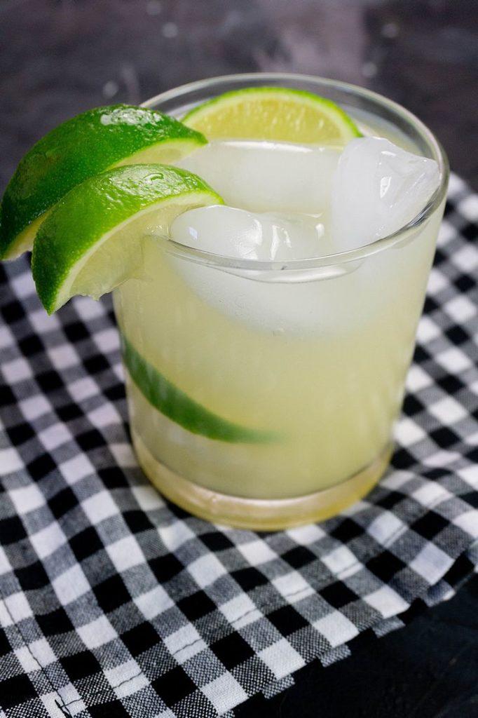 Key Lime Pie Moonshine Cocktail on slate with plaid napkin