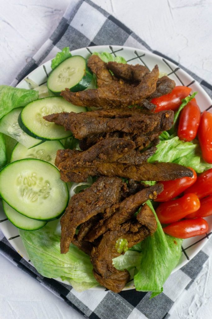 Instant Pot Beef Shawarma with small tomatoes and sliced cucumbers