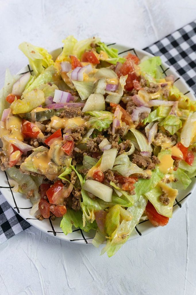 Big mac salad with pickles and tomatoes