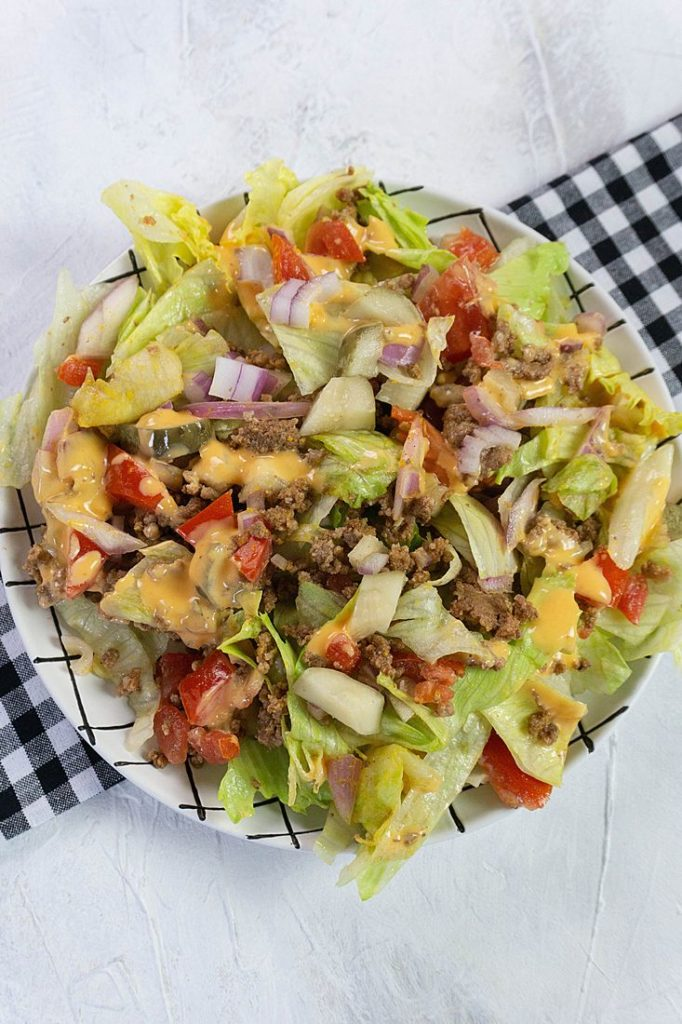 Big Mac Salad with tomatoes, pickles, and onions.