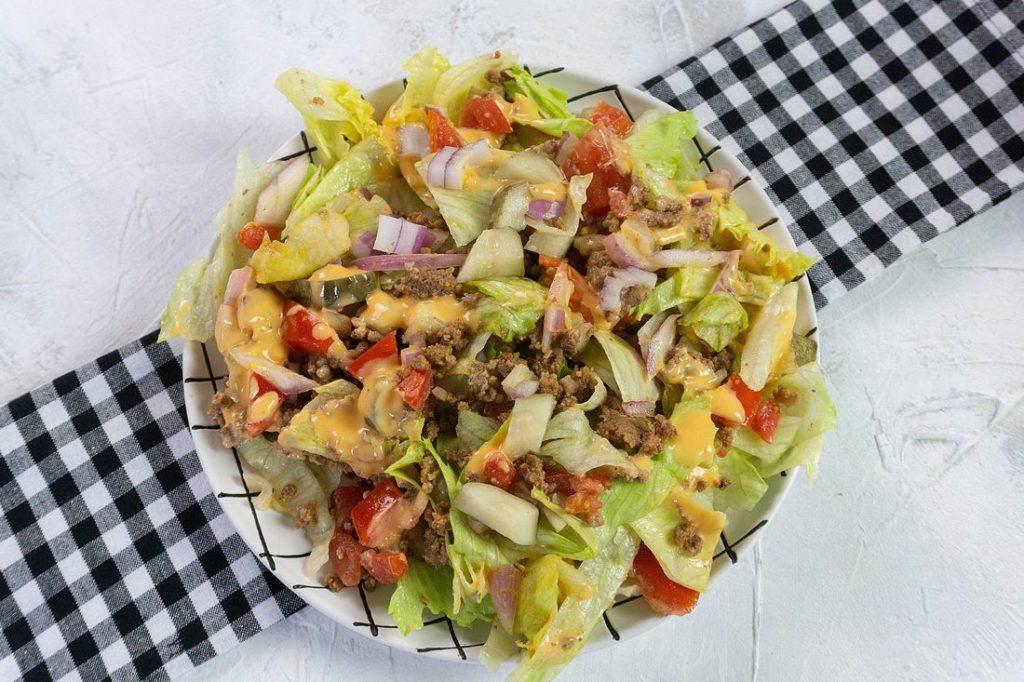 Big Mac Salad on white background with plaid napkin