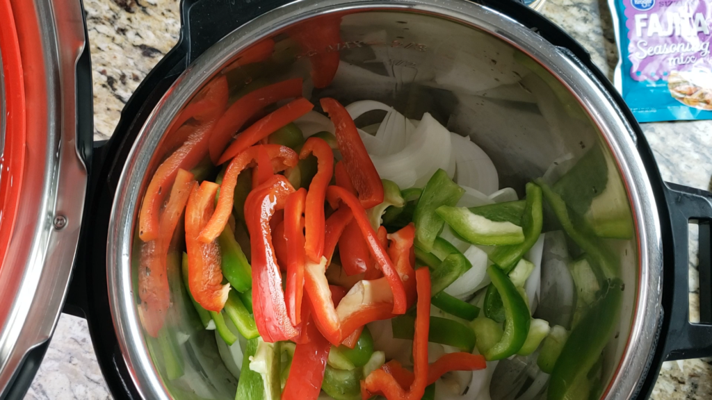 Onions and bell peppers inside the instant pot