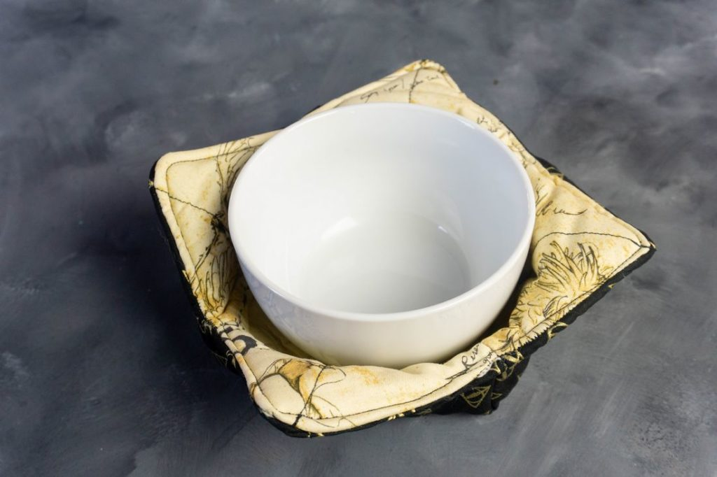 Harry Potter soup bowl cozy with white bowl in it.