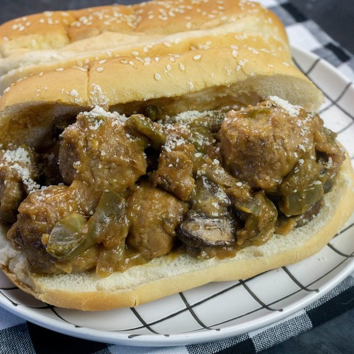 Instant Pot Philly Cheese Steak Meatballs on black with plaid napkin