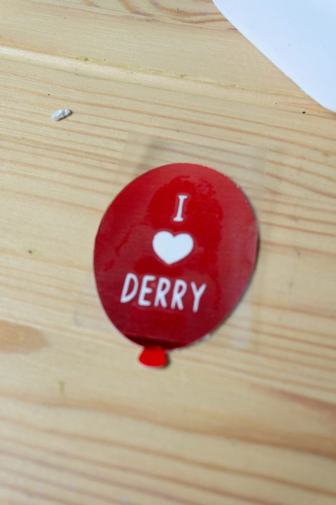 Red Balloon on wood that says I Heart Derry