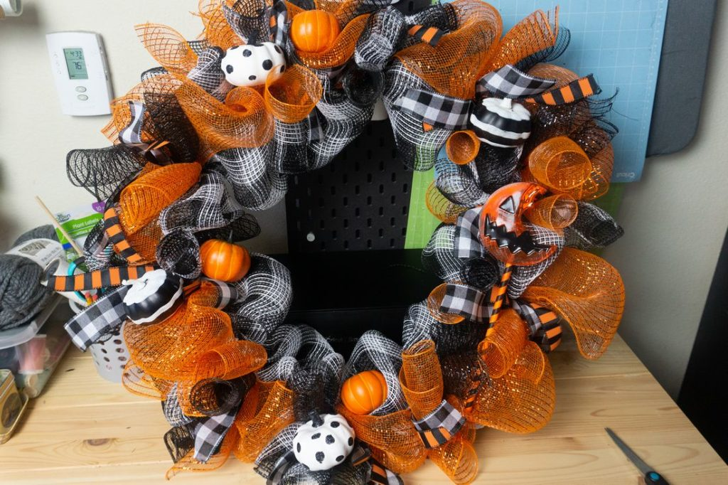 Wreath with pumpkins staged.