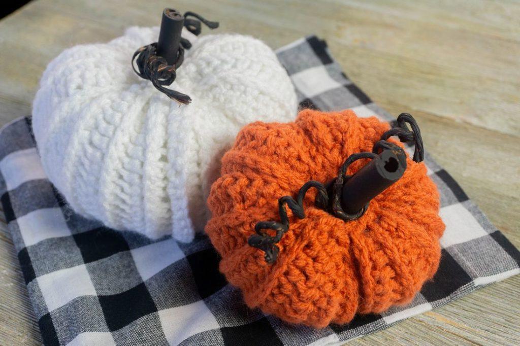 Farmhouse Crochet Pumpkins on plaid and gray wood.