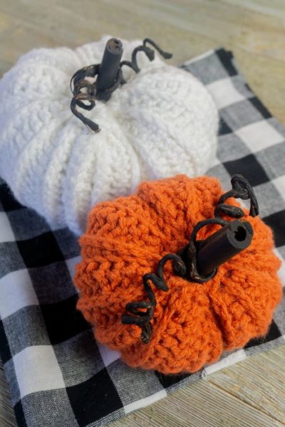 Farmhouse Crochet Pumpkins on plaid and gray wood.