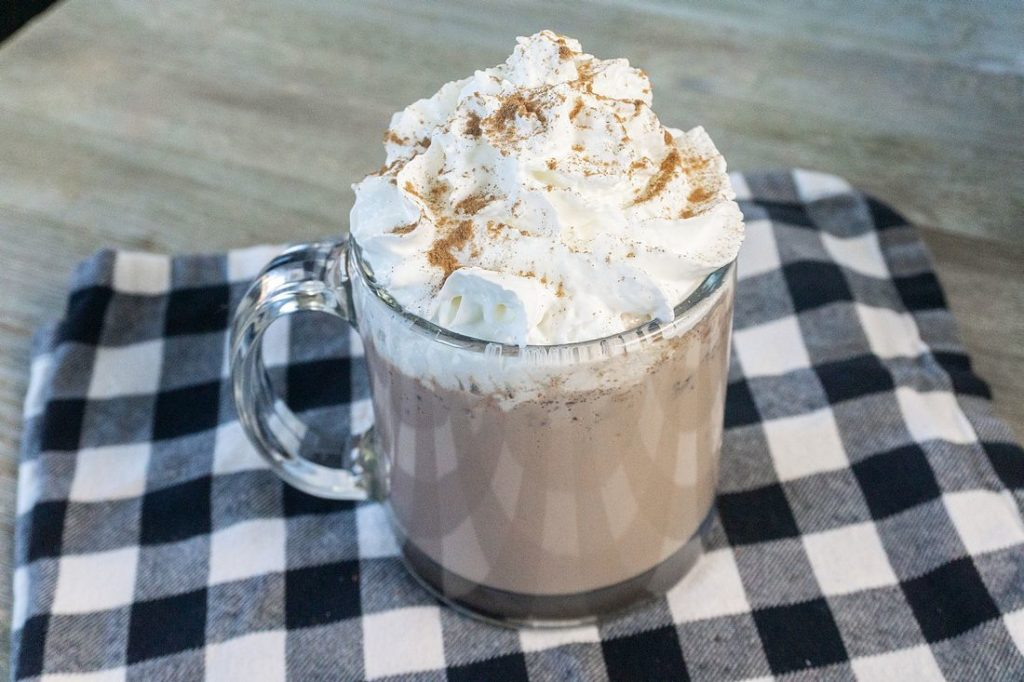 Instant Pot Double Hot Chocolate on grey wood board with plaid napkin