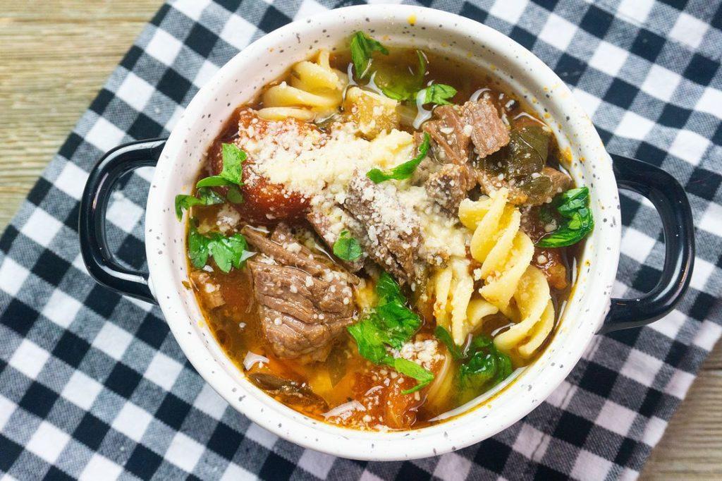 Instant Pot Beef Parmesan Soup on plaid napkin