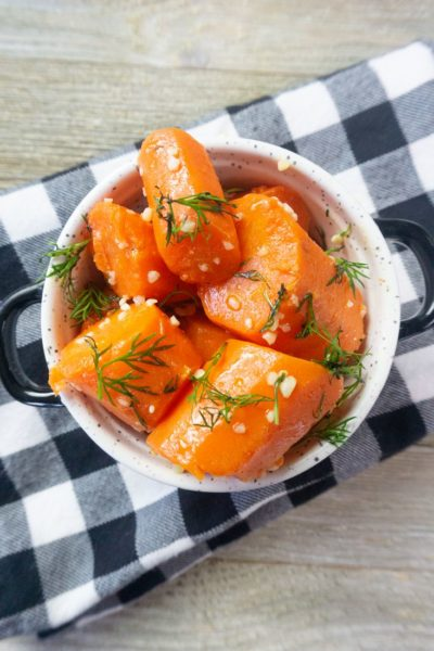 Instant Pot Garlic Dill Carrots on grey wood in a white bowl