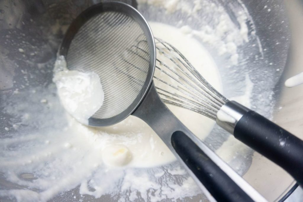 Spider and tongs in pancake batter