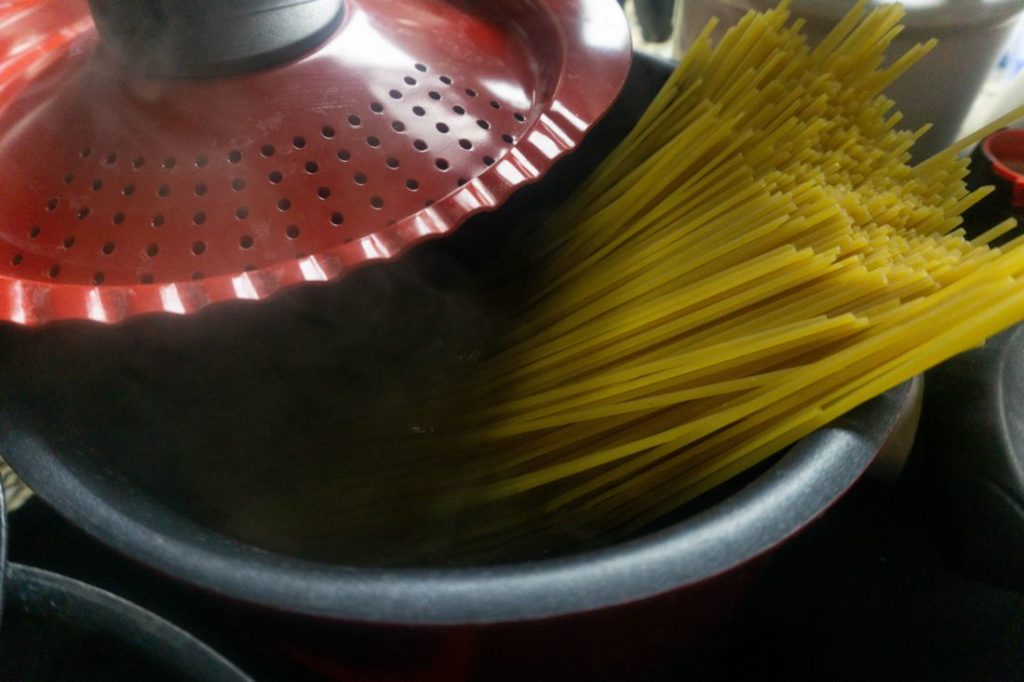 Pasta in a red pot with water
