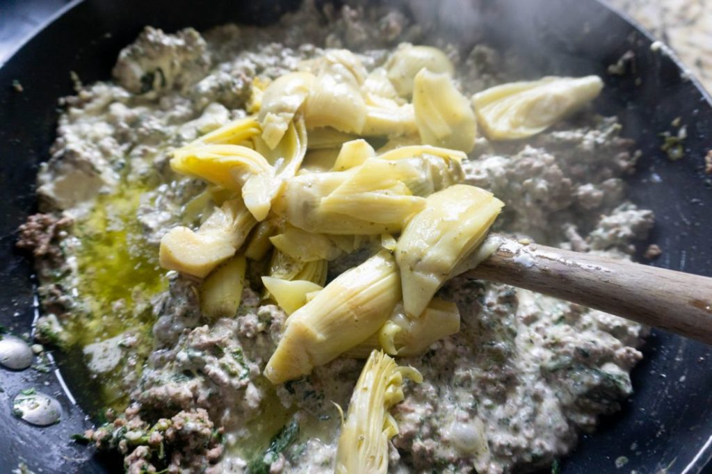 artichoke hearts with the ground beef mixture